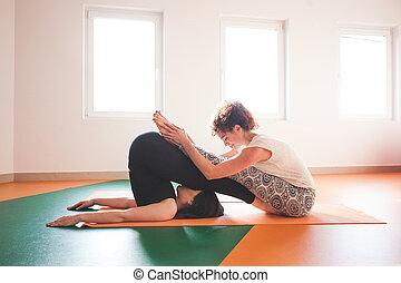 two young women doing yoga  indoor