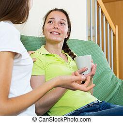 Two young women enjoying a conversation