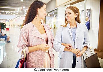 Two Young Women Enjoying Shopping