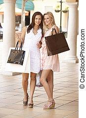 Two Young Women Enjoying Shopping Trip Together