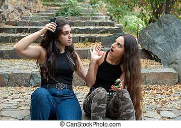 Two young women fighting and pulling each others hair