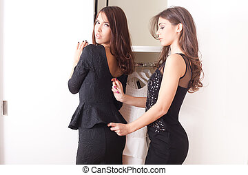 dress-up - two young women in front of closet dress-up