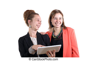 Two young women in office working