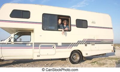 two young women in the autotrailer window
