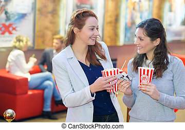 two young women in the cinema