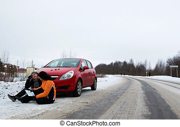 two young women lost on the road and waiting