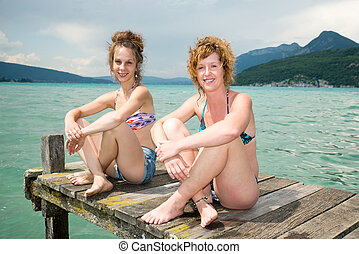 two young women natural  at the waterfront