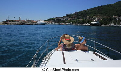 two young women on the bow of the boat enjoying the scenery