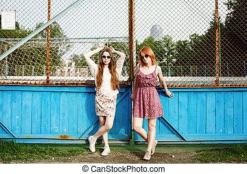Two young women posing near the court