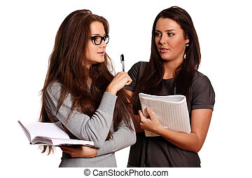 two young women reading books