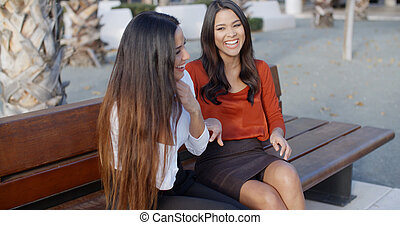 Two young women sharing a good joke