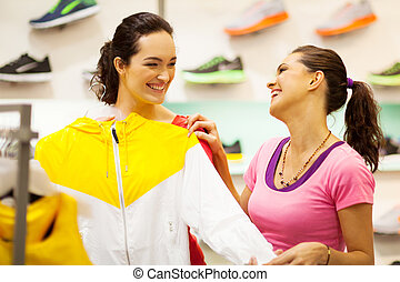 women shopping for sportswear in mall