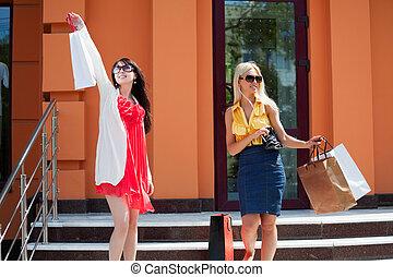 Two young women shopping