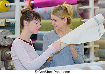 two young women standing in store