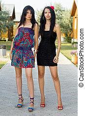 young women standing on the walkway
