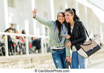 Two young women taking a self portrait of themselves