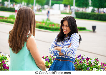 Two young women talking to each other