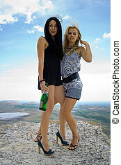 Two young women with a champagne bottle