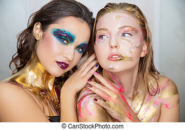 Two young women with creative make-up