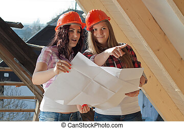 Two young women workers on the roof