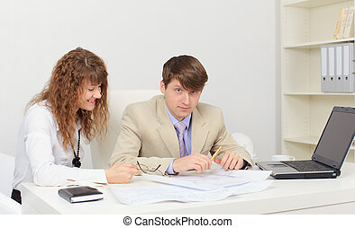 Two young worker at workplace