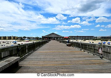 Wooden fishing pier background at Tybee Island, Georgia, USA