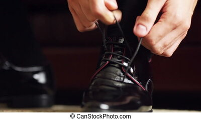 Tying shoelaces - Close-up of tying the laces on expensive...