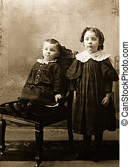 victorian photograph of young girl and baby brother