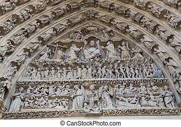 Tympanum of Cathedral of Our Lady of Amiens (French: Cathédrale Notre-Dame d'Amiens), the tallest cathedral in France, located in Amiens, Somme region, Picardy, France. This cathedral including all its statues were created in the 13th Century and photographed from a public standpoint, no property ...