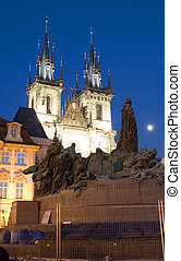 Tyn Church and statue monument of Jan Hus at night Old Town Square Prague Czech Republic