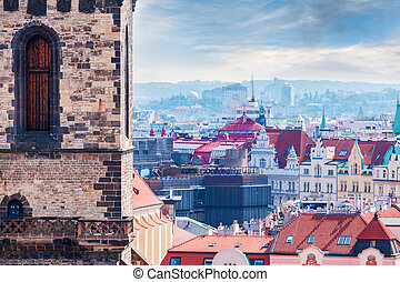 Tyn Church details against the backdrop of the city, Prague