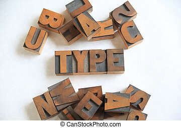 Type word with assorted wood letters