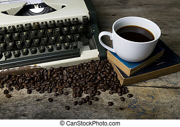 typewriter and coffee on wood background