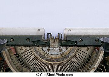 Typewriter and empty white paper