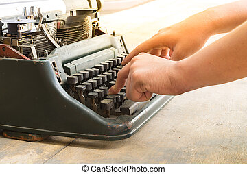 Typewriter and human hand