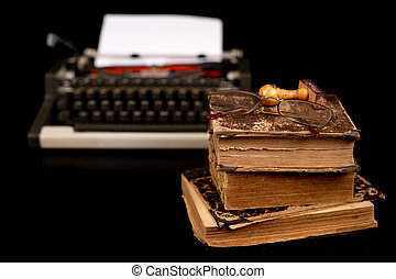 Typewriter and old books. Writer's place of work. Dark ...