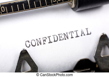confidential - Typewriter close up shot, Concept of...