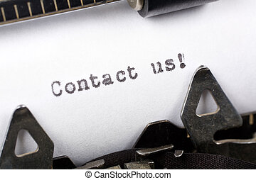Contact us - Typewriter close up shot, concept of Contact us