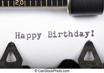 Typewriter close up shot, concept of Happy Birthday