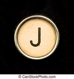 The J button on a complete alphabet of an antique typewriter