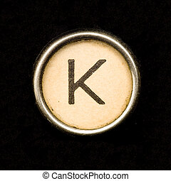 The K button on a complete alphabet of an antique typewriter