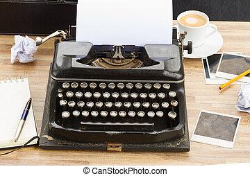 typewriter - black vintage typewriter with empty white page...