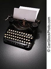 Typewriter - a typewriter in dramatic lighting.