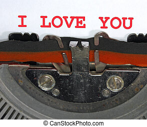 Typewriter Types I LOVE YOU Closeup with red ink