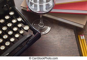 Typewriter Wine Books - Old vintage typewriter with glass of...