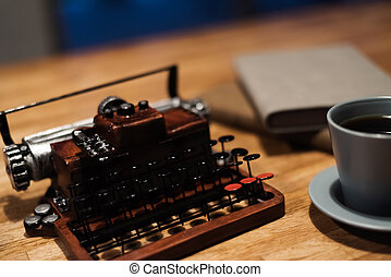 typewriter with a cup of coffee