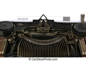 An old fashioned typewriter with a search box. Closeup of the antique machines ribbon and carriage with a modern technology search box on the paper.