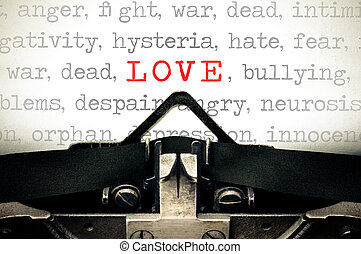 Typewritter with the word Love