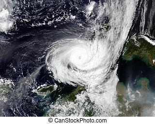 Typhoon over planet Earth - satellite photo.
