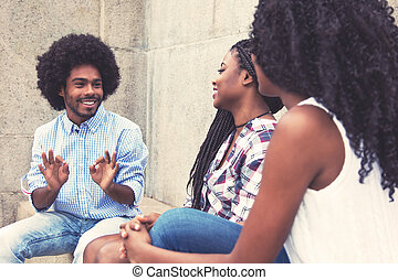 Typical african american man with two women